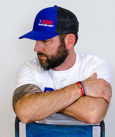 Bullets Both Ways royal Blue trucker hat